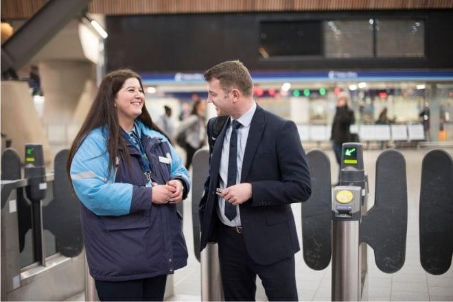 Female colleague Veronica Dumitru, station staff helping passenger at London Bridge