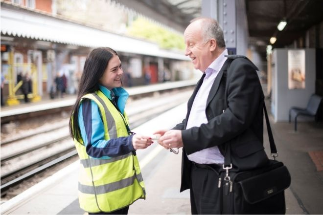 Female colleague Emily, platform staff helping passenger at Tunbridge Wells station