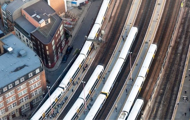 birdseye view of trains pulling into stations