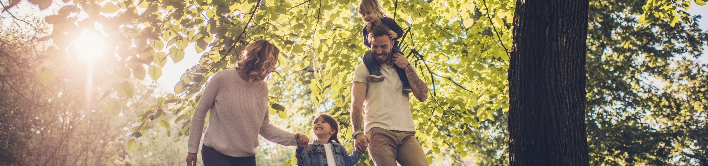 a family walking through the woods and laughing