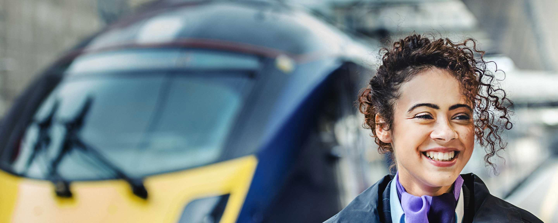 Smiley woman next to train