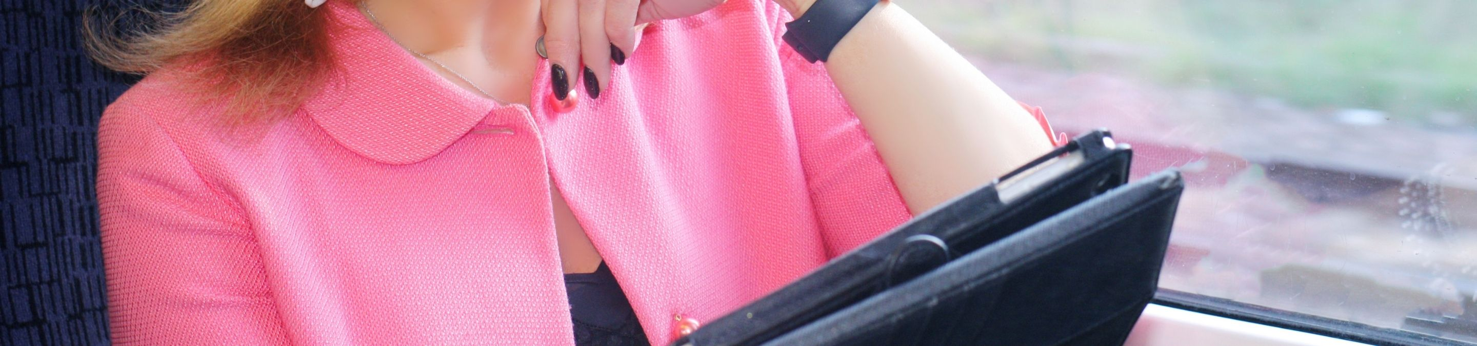 a close up of a person holding a piece of luggage