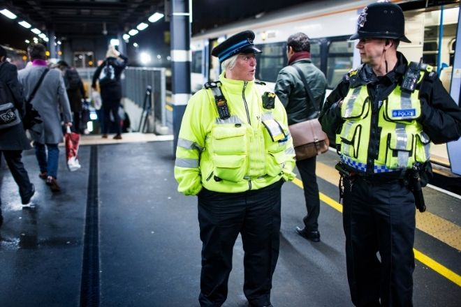 two revenue officers working at a train station