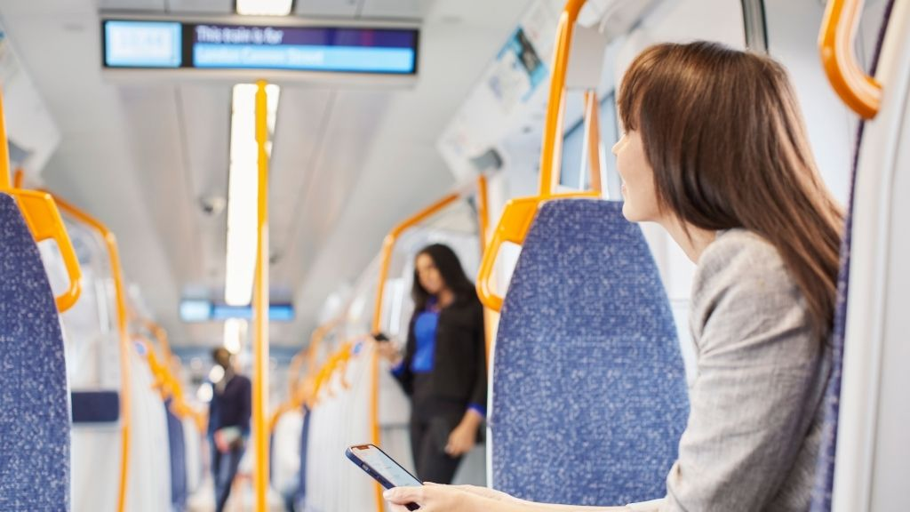 a woman sitting on a train