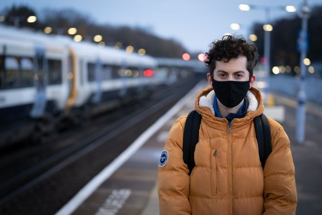 a person standing in a train station