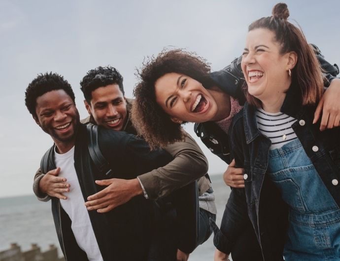 a group of people laughing together