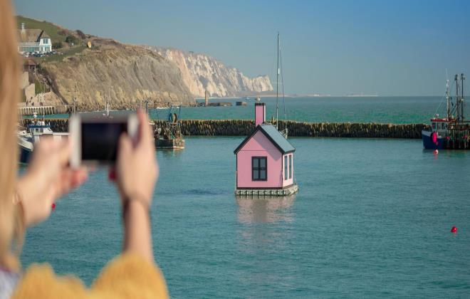 Lady taking picture of the sea